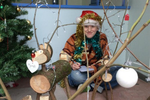 client-and-finished-reindeers-good-photo.jpg - Recycled wood workshop for young homeles