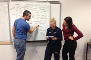 coaches-at-the-whiteboard.jpeg - West Lothian Wolves Lair Project