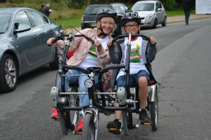 event-helpers-enjoying-the-accessible-bikes.jpg - One Wirral 2018