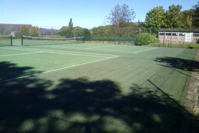 Resurfacing local tennis courts